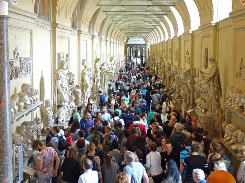 Visitors inside the Vatican Museums in Rome